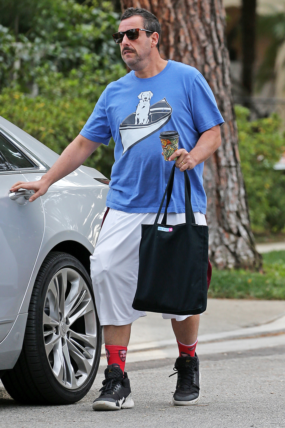 Adam Sandler wears 'Adam Sandler socks' while out and about in Beverly Hills, CA