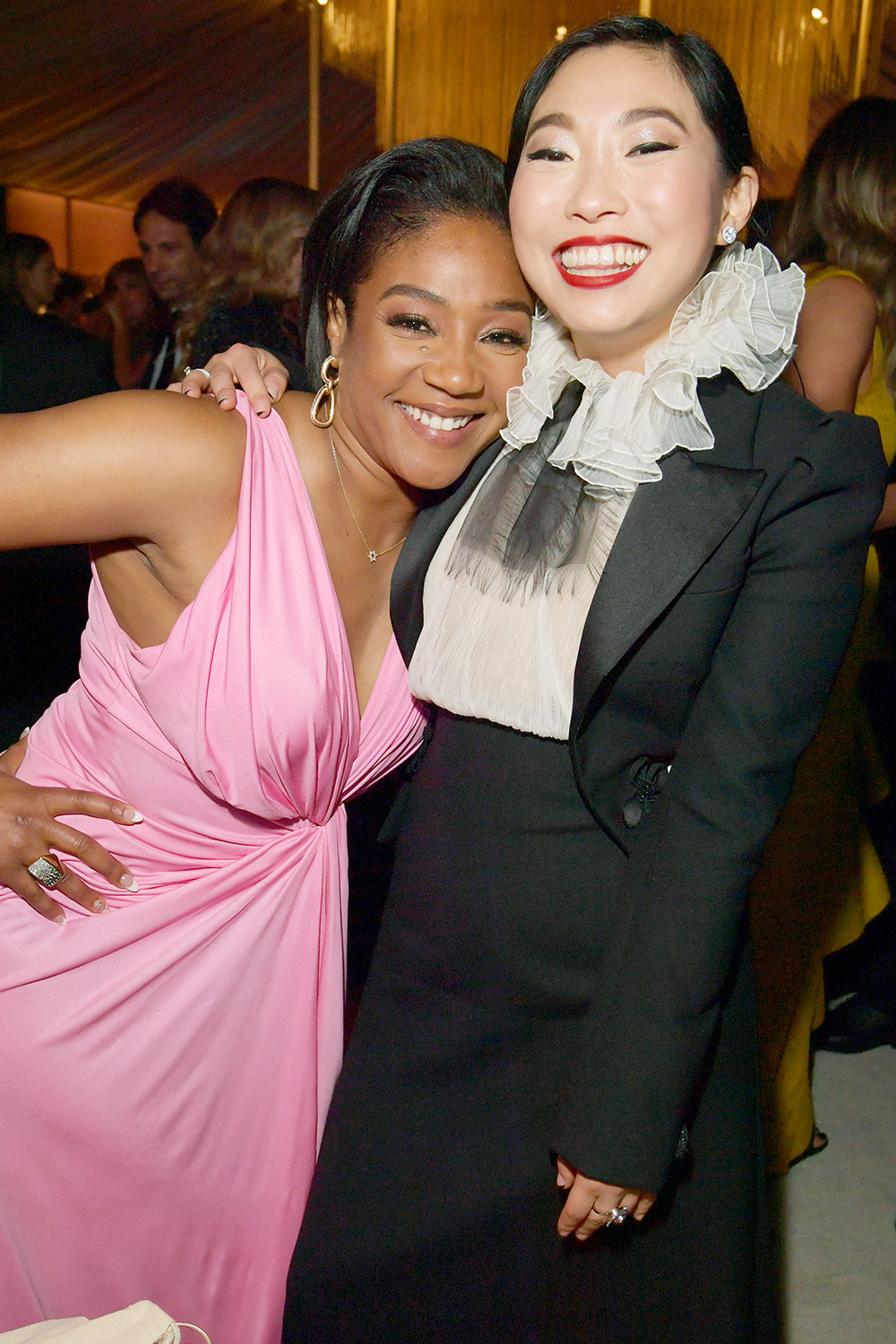 Tiffany Haddish and Awkwafina attend The 2020 InStyle And Warner Bros. 77th Annual Golden Globe Awards Post-Party at The Beverly Hilton Hotel on January 05, 2020 in Beverly Hills, California