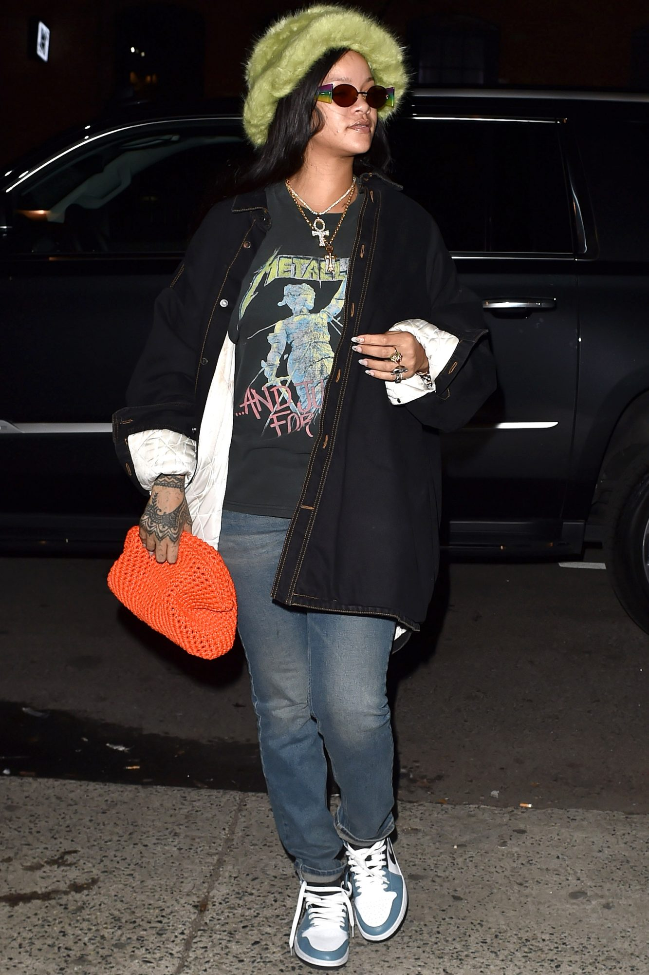 Rihanna Is Seen Out In New York, Rihanna Was Seen Wearing A Bright Green Hat And A Metallica T-Shirt And Jeans As She Took A Trip Downtown.