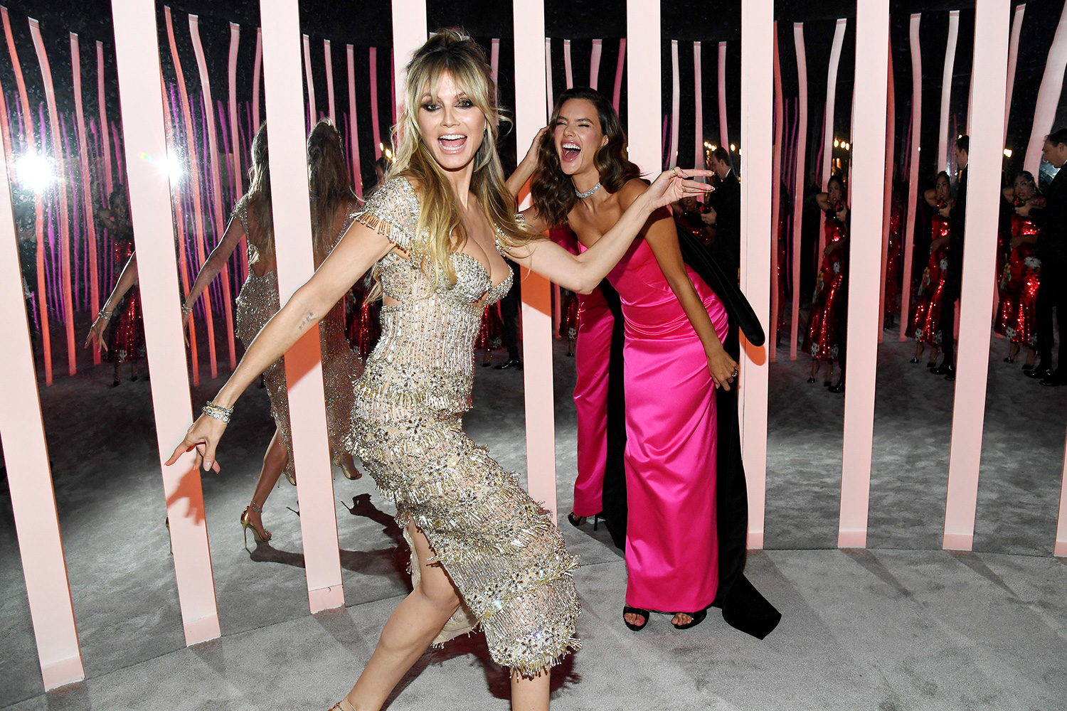 Heidi Klum and Alessandra Ambrosio attend the 2020 Vanity Fair Oscar Party hosted by Radhika Jones at Wallis Annenberg Center for the Performing Arts on February 09, 2020 in Beverly Hills, California