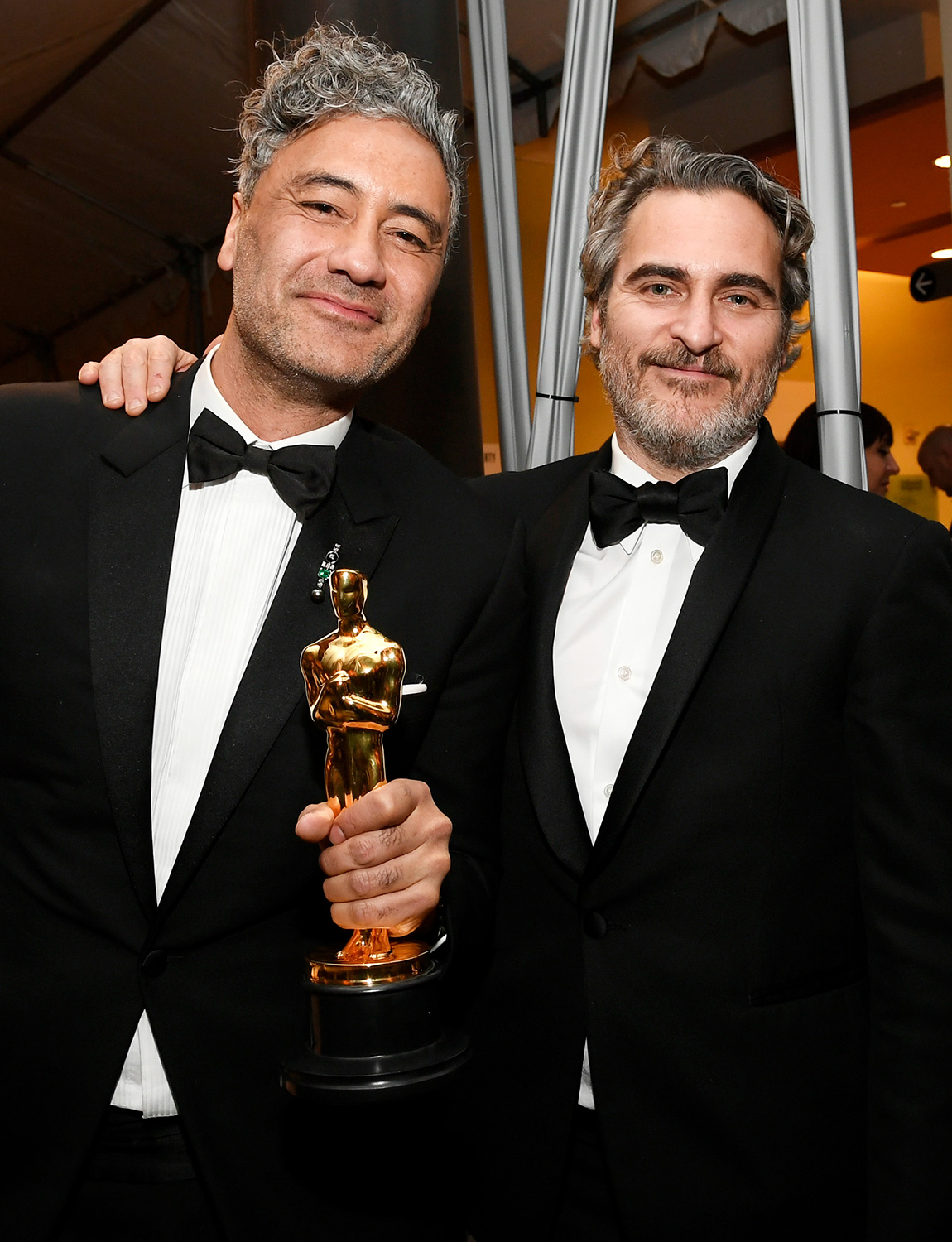 """Director Taika Waititi, winner of the Adapted Screenplay award for """"Jojo Rabbit"""" and Joaquin Phoenix, winner of the Actor in a Leading Role award for """"Joker,"""" attend the 92nd Annual Academy Awards Governors Ball at Hollywood and Highland on February 09, 2020 in Hollywood, California"""