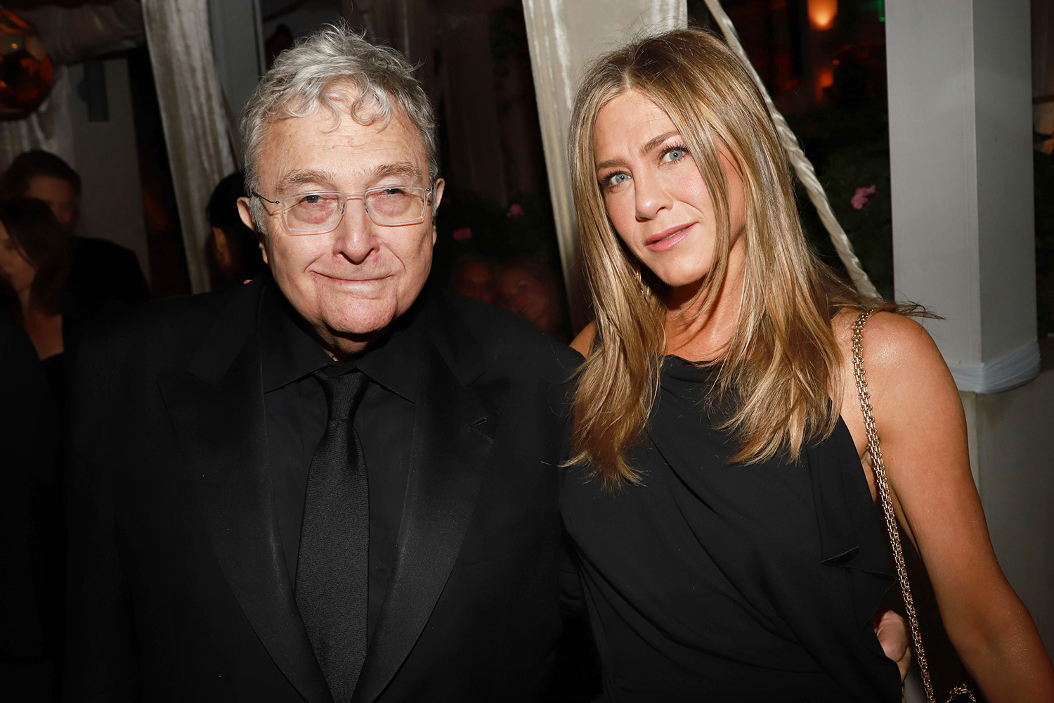 Randy Newman and Jennifer Aniston attend the 2020 Netflix Oscar After Party at San Vicente Bugalows on February 09, 2020 in West Hollywood, California