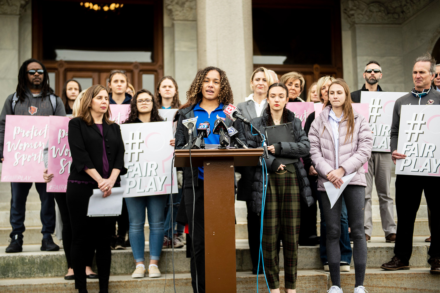 Canton High School senior Chelsea Mitchel speaks during a press conference with Alanna Smith, Danbury High School sophomore, to her left and Selina Soule, Glastonbury High School senior, to her right at the Connecticut State Capitol Wednesday, Feb. 12, 2020, in downtown Hartford, Conn