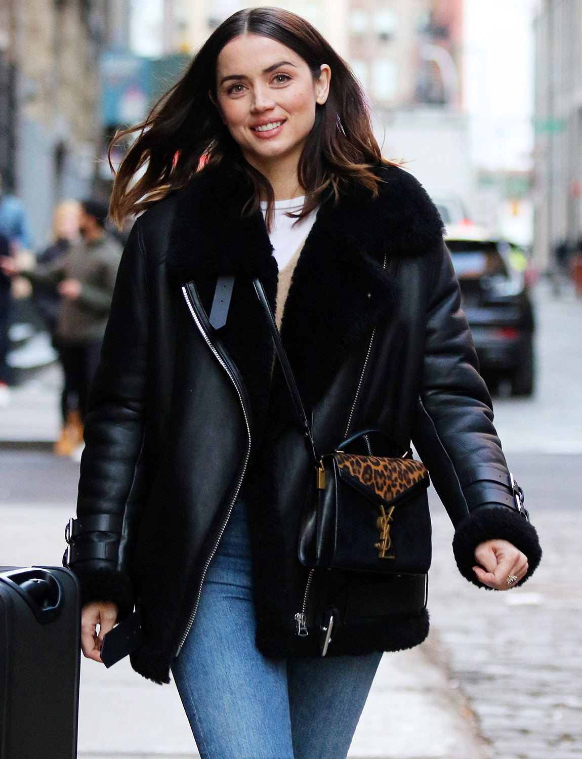 """Upcoming """"No Time To Die"""" bond girl star Ana De Armas is all smiles while shopping in Manhattan's Soho area. Ana was seen looking very stylish sporting a YSL handbag"""