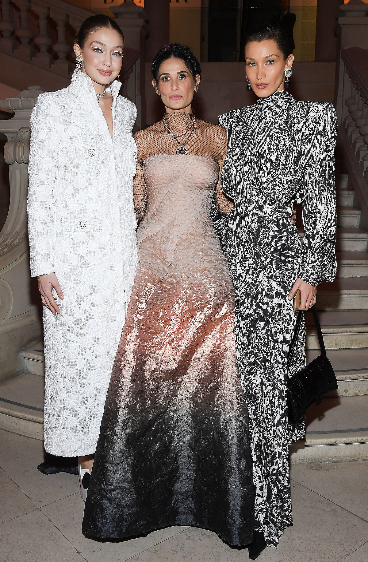 Gigi Hadid, Demi Moore and Bella Hadid attend the Harper's Bazaar Exhibition as part of the Paris Fashion Week Womenswear Fall/Winter 2020/2021 At Musee Des Arts Decoratifs on February 26, 2020