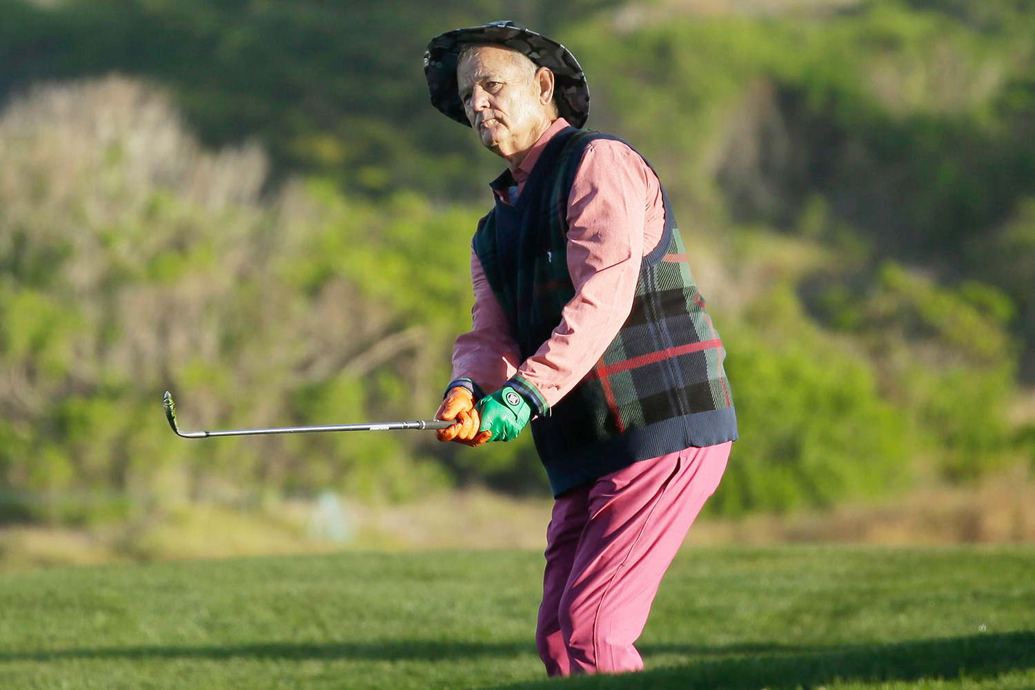 Bill Murray follows his chip shot to the 10th green of the Monterey Peninsula Country Club Shore Course during the second round of the AT&T Pebble Beach National Pro-Am golf tournament, in Pebble Beach, Calif Golf, Pebble Beach, USA - 07 Feb 2020