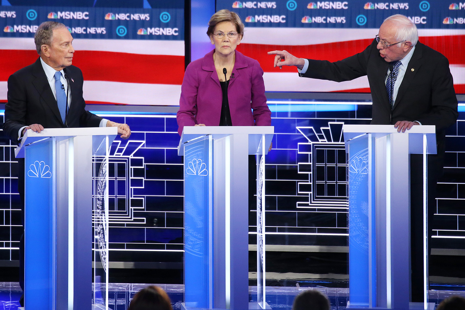 Democratic presidential candidate Sen. Bernie Sanders (I-VT) (R) gestures as Sen. Elizabeth Warren (D-MA) and former New York City mayor Mike Bloomberg listen during the Democratic presidential primary debate at Paris Las Vegas on February 19, 2020 in Las Vegas