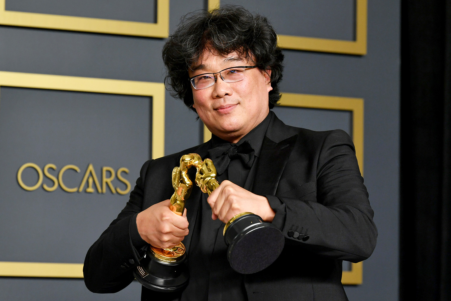 "Bong Joon-ho, winner of the Original Screenplay, International Feature Film, Directing, and Best Picture awards for ""Parasite,"" poses in the press room during the 92nd Annual Academy Awards at Hollywood and Highland on February 09, 2020 in Hollywood, California"