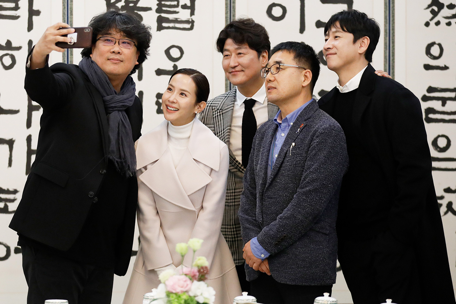 Bong Joon-ho takes a selfie with cast members Song Kang-ho, Cho Yeo-jeong and Lee Sun-kyun at the Presidential Blue House on February 20, 2020 in Seoul, South Korea