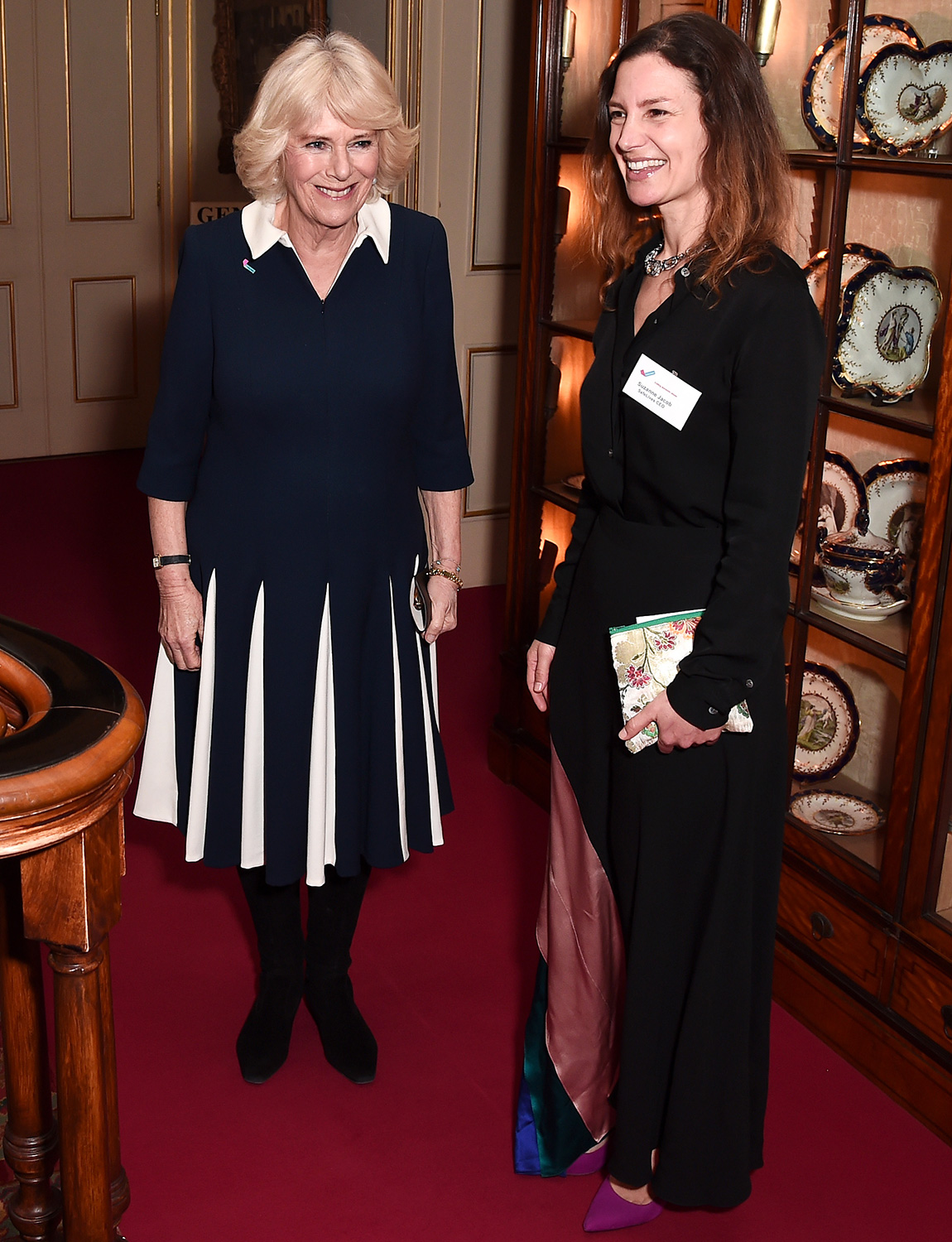 Camilla, Duchess of Cornwall is greeted by CEO of SafeLives Suzanne Jacob as she hosts a reception to acknowledge the 15th anniversary of domestic abuse charity SafeLives at Clarence House on February 12, 2020 in London, England