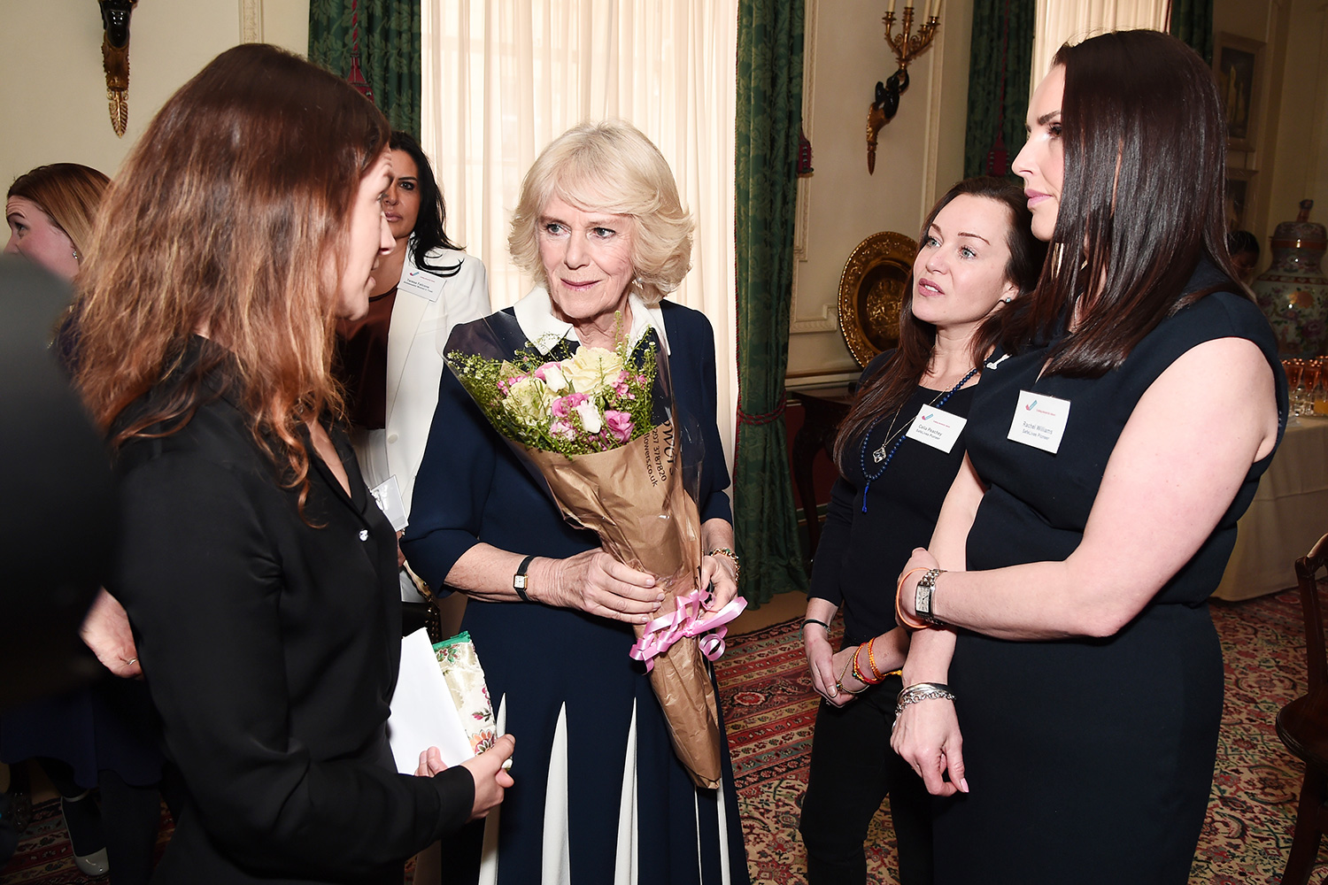 Camilla, Duchess of Cornwall (2nd L) is greeted by CEO of SafeLives Suzanne Jacob (L) and SafeLives Pioneers Celia Peachey and Rachel Williams during a reception to acknowledge the 15th anniversary of domestic abuse charity SafeLives at Clarence House on February 12, 2020 in London, England