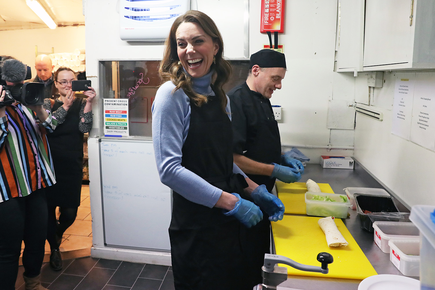 The Duchess of Cambridge, known as the Countess of Strathearn while in Scotland, speaks to users of the Social Bite cafe, during a visit to Aberdeen, to meet with locals for her Early Childhood survey.