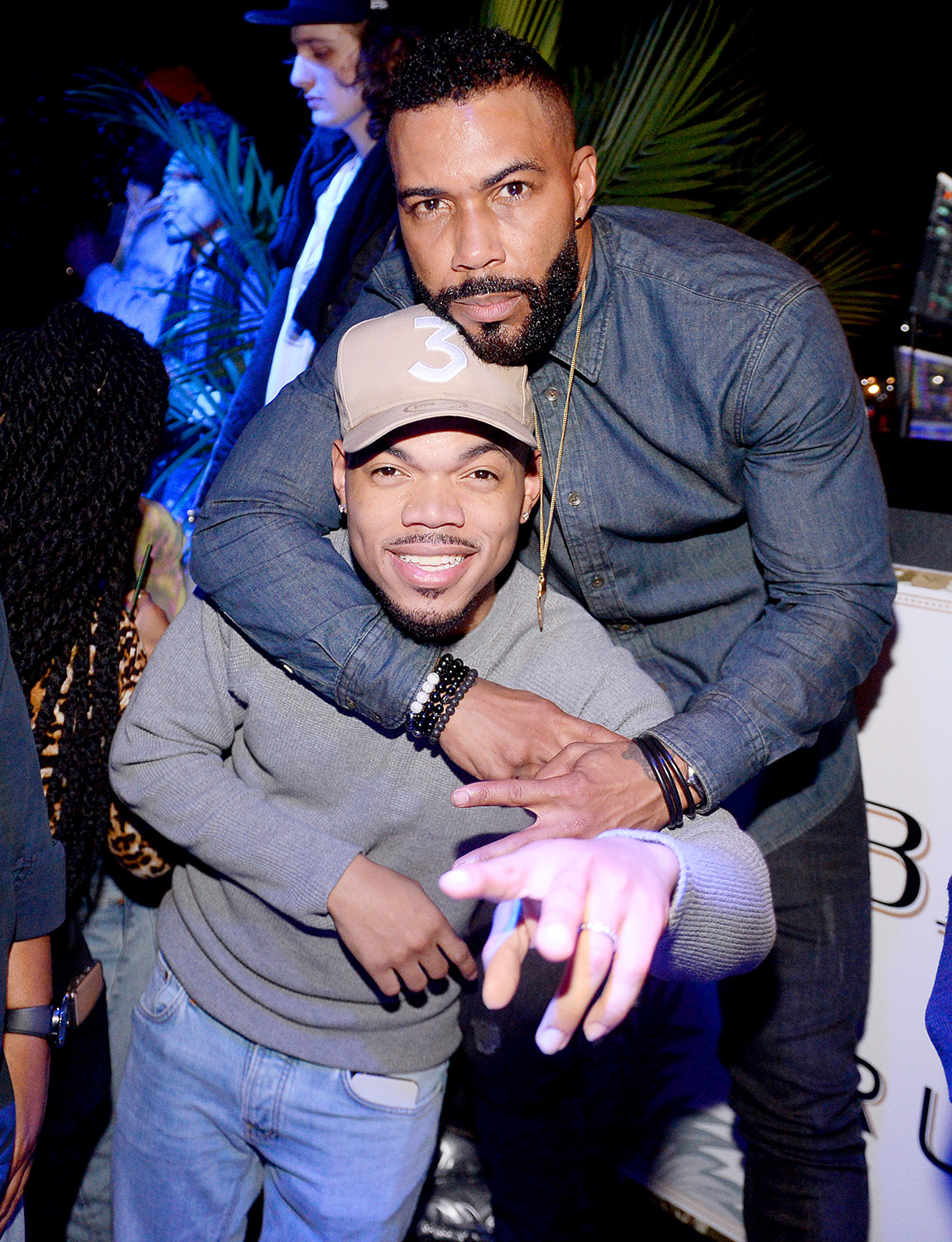 Chance the Rapper and Omari Hardwick hug at the BACARDI Rum Room in Chicago at Il Porcellino on February 13, 2020 in Chicago, Illinois