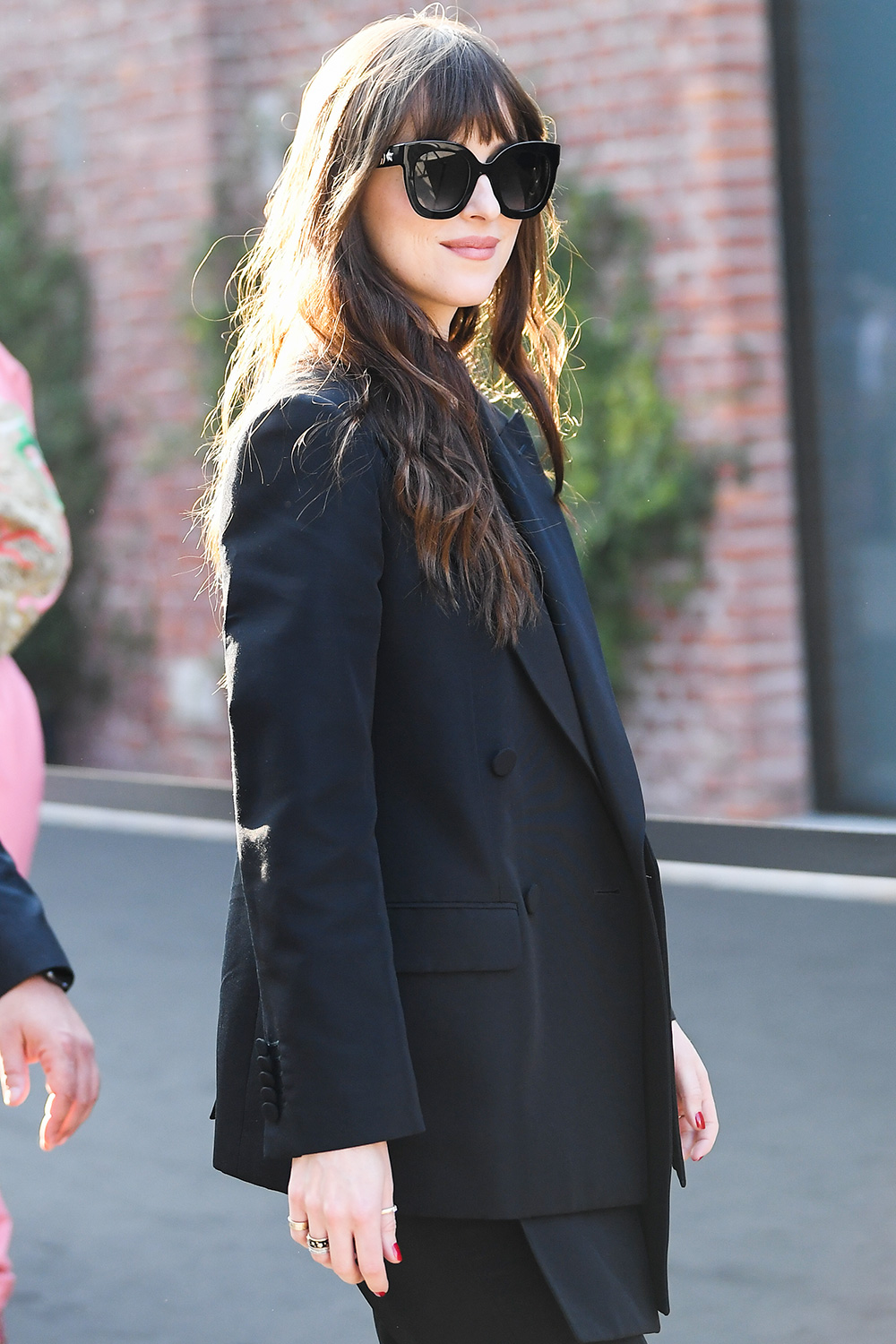 Dakota Johnson attends the Gucci fashion show on February 19, 2020 in Milan, Italy