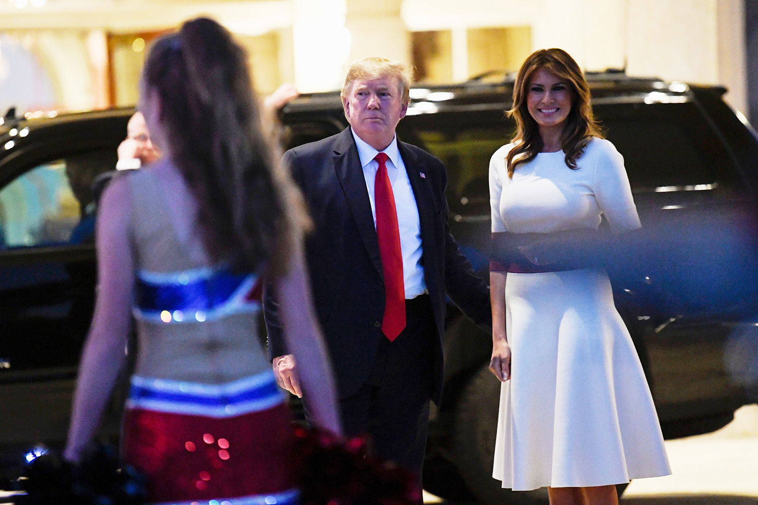 Donald Trump, Melania Trump. President Donald Trump and first lady Melania Trump watch as the Florida Atlantic University Marching Band performs at the Trump International Golf Club in West Palm Beach, Fla., . The Trumps are attending a Super Bowl party at the golf club Trump, West Palm Beach, USA - 02 Feb 2020