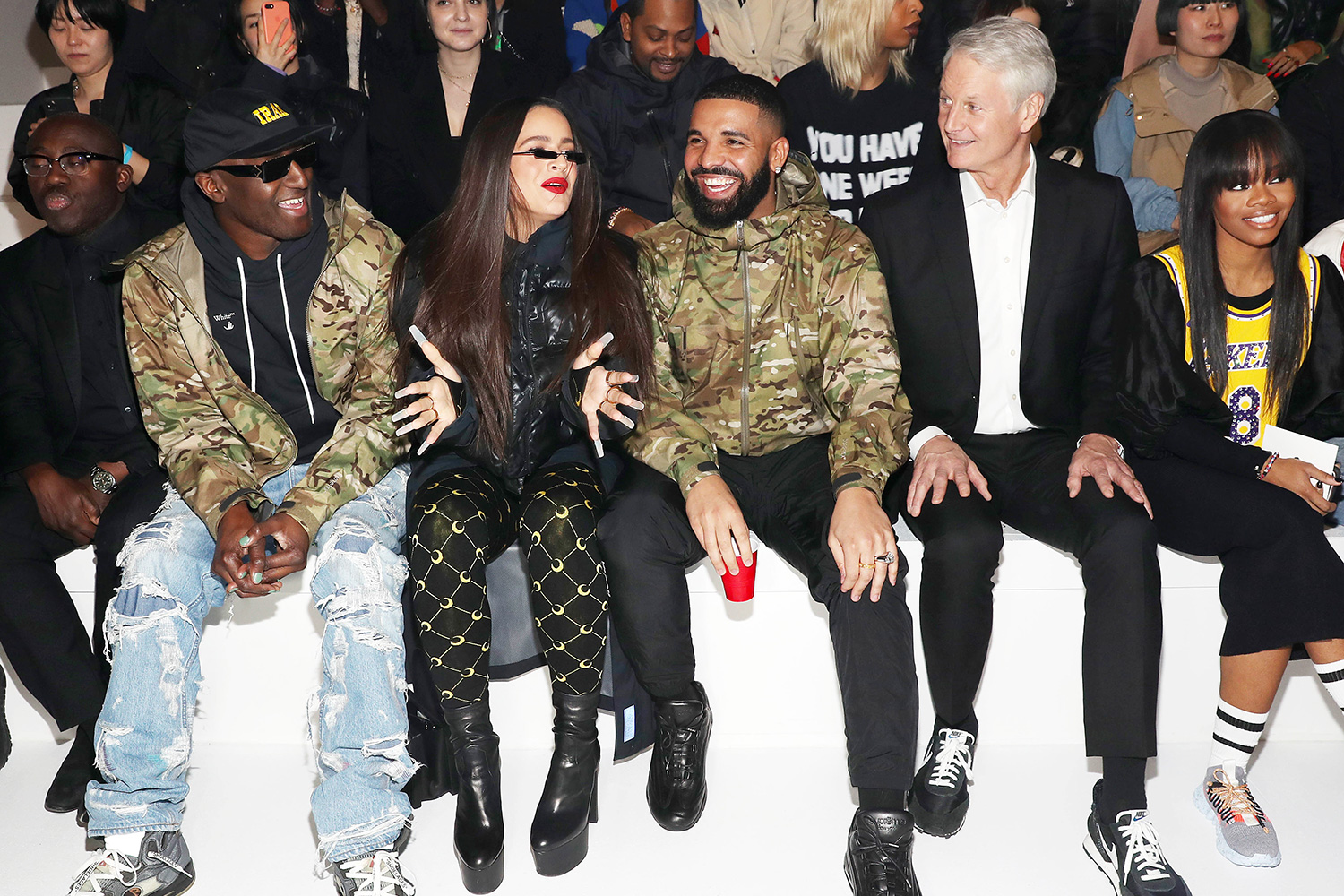Edward Enninful, Virgil Abloh, Rosalia, Drake, John Donahoe, and Gabby Douglas attend the 2020 Tokyo Olympic collection fashion show at The Shed on February 05, 2020 in New York City