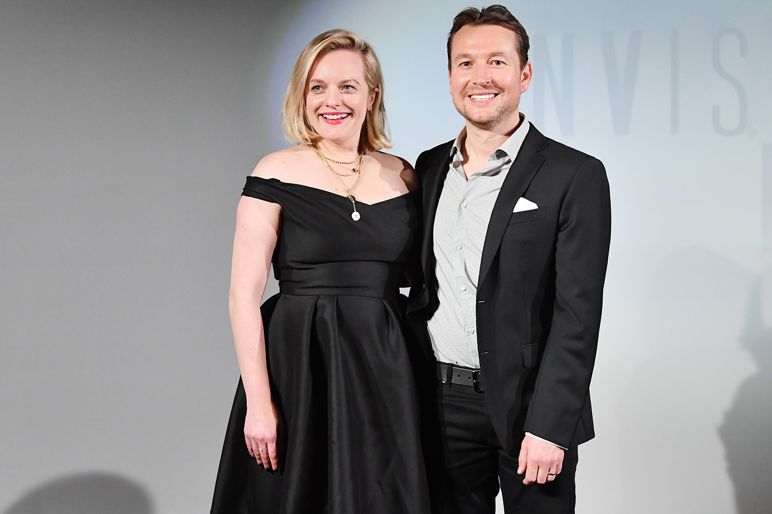 """Elisabeth Moss and Director Leigh Whannel attend the """"Invisible Man"""" premiere at Gaumont Champs ELysees on February 17, 2020 in Paris, France"""