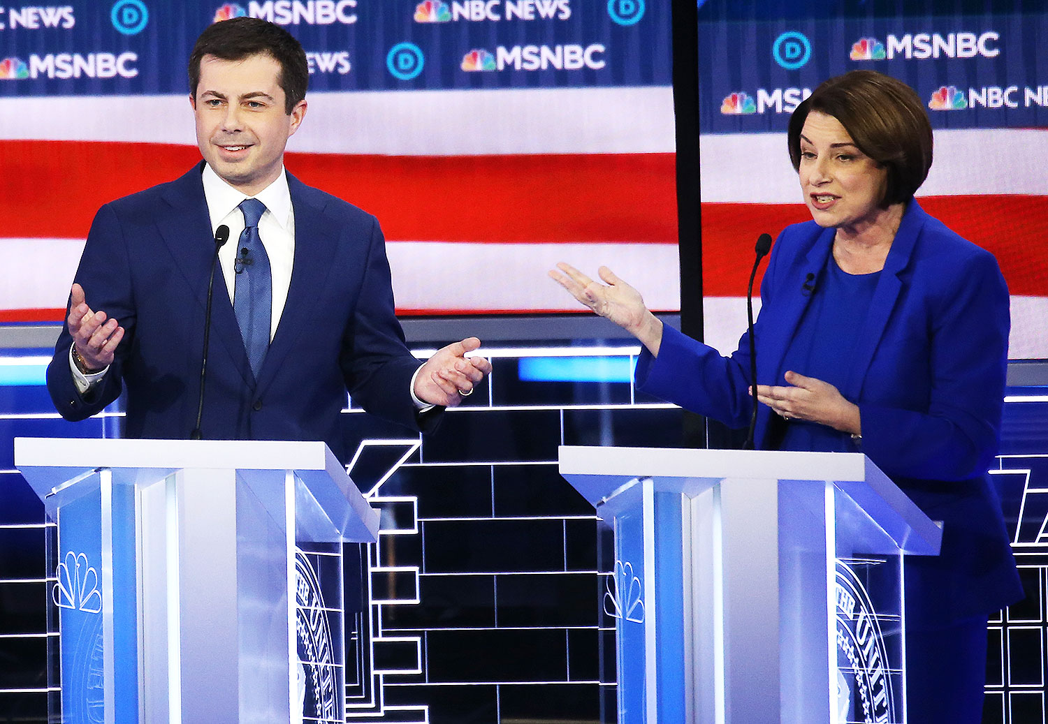 Democratic presidential candidate former South Bend, Indiana Mayor Pete Buttigieg (L) and Sen. Amy Klobuchar