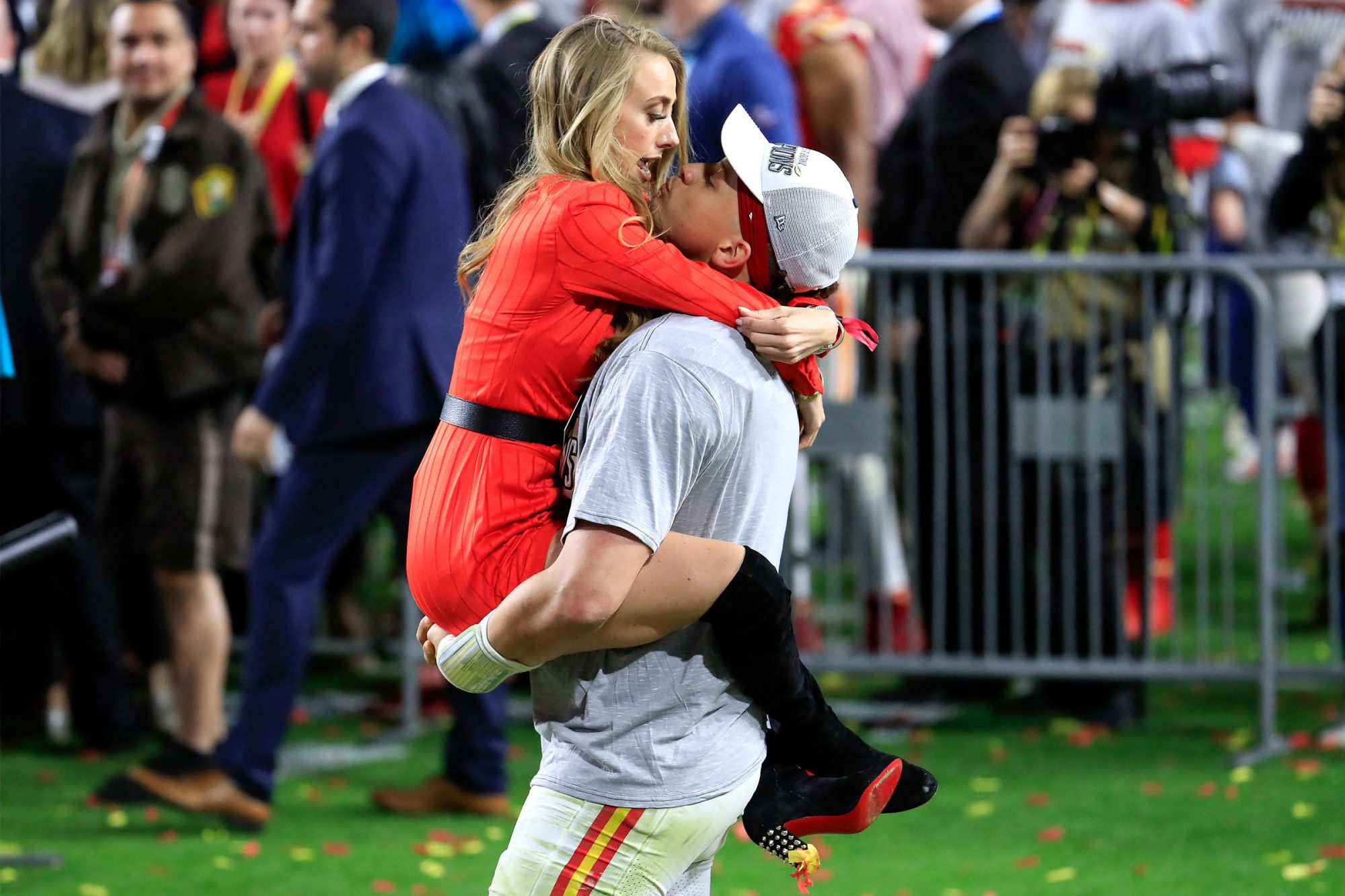 Patrick Mahomes #15 of the Kansas City Chiefs celebrates with his girlfriend, Brittany Matthews