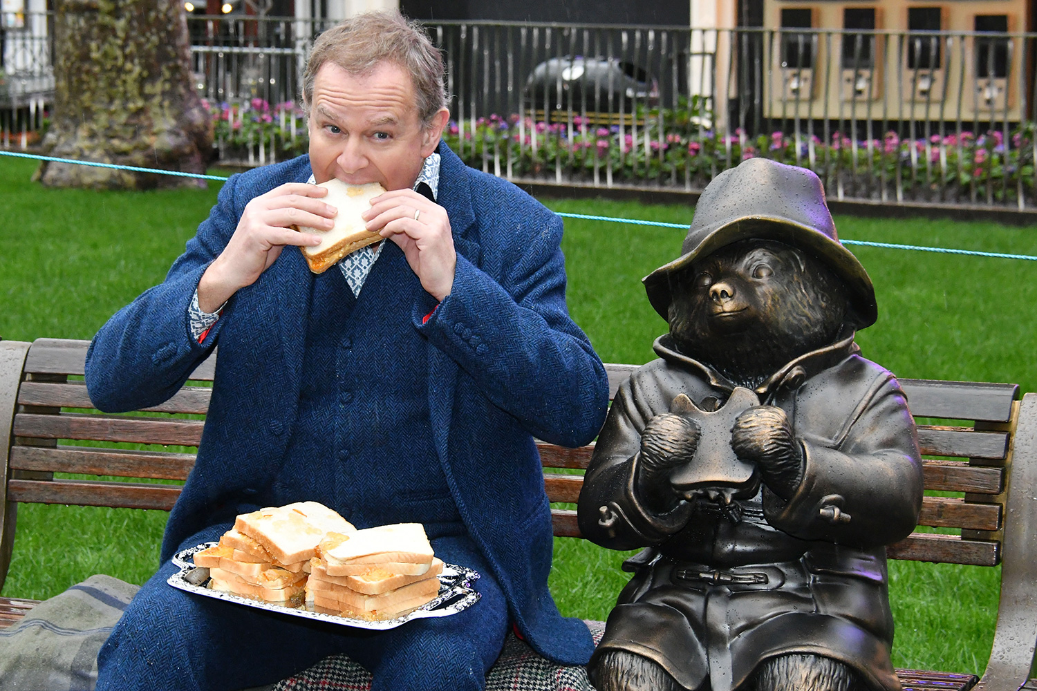 Hugh Bonneville unveils Paddington at unveiling of a trail of cinematic bronze statues in London's Leicester Square, celebrating the location's rich history as the home of film and marking the square's 350th anniversary.