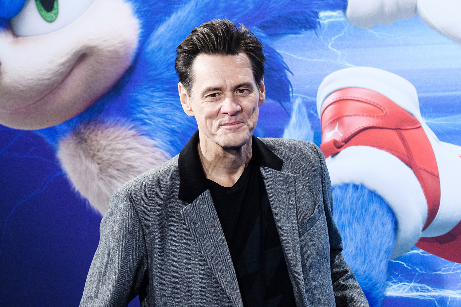 Jim Carrey poses on the blue carpet of the 'Sonic the Hedgehog' fan screening in Berlin, Germany, 28 January 2020