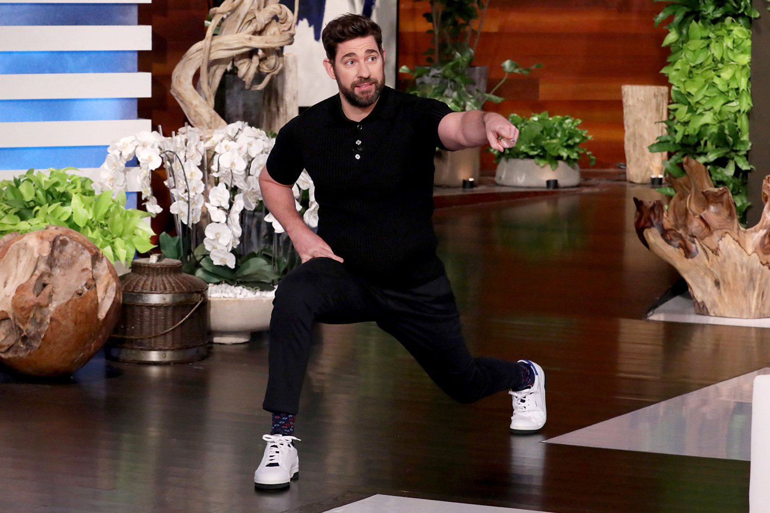 "Writer, director, producer, and star of ""A Quiet Place Part II,"" John Krasinski lunges out onto ""The Ellen DeGeneres Show"" stage on Monday, February 10th"