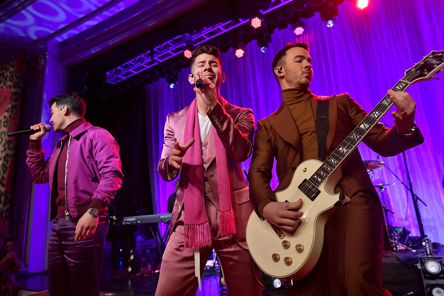 """Joe Jonas, Nick Jonas, and Kevin Jonas of The Jonas Brothers perform onstage during WCRF's """"An Unforgettable Evening"""" at Beverly Wilshire, A Four Seasons Hotel on February 27, 2020 in Beverly Hills, California"""