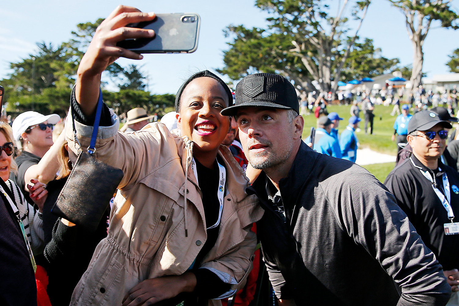 Josh Duhamel takes a selfie with a fan during the 3M Celebrity Challenge prior to the AT&T Pebble Beach Pro-Am at Pebble Beach Golf Links on February 05, 2020 in Pebble Beach, California