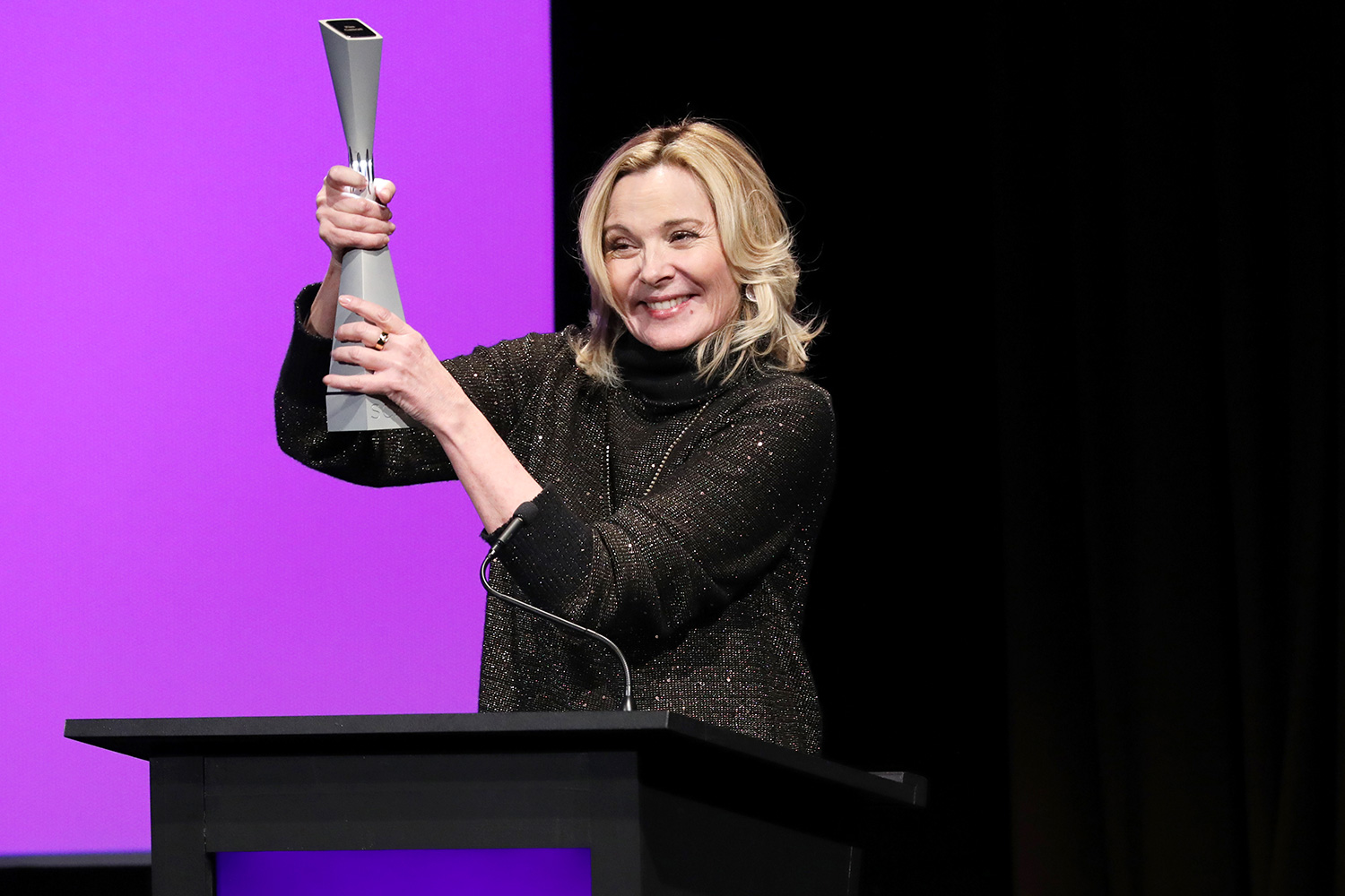 """Kim Cattrall accepts the 2020 Icon Award on stage during the SCAD aTVfest 2020 - """"Filthy Rich"""" With Kim Cattrall Icon Award Presentation on February 27, 2020 in Atlanta, Georgia"""
