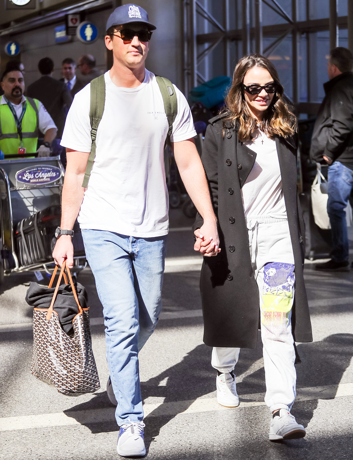 Miles Teller and Keleigh Sperry are seen at Los Angeles International Airport in Los Angeles, California