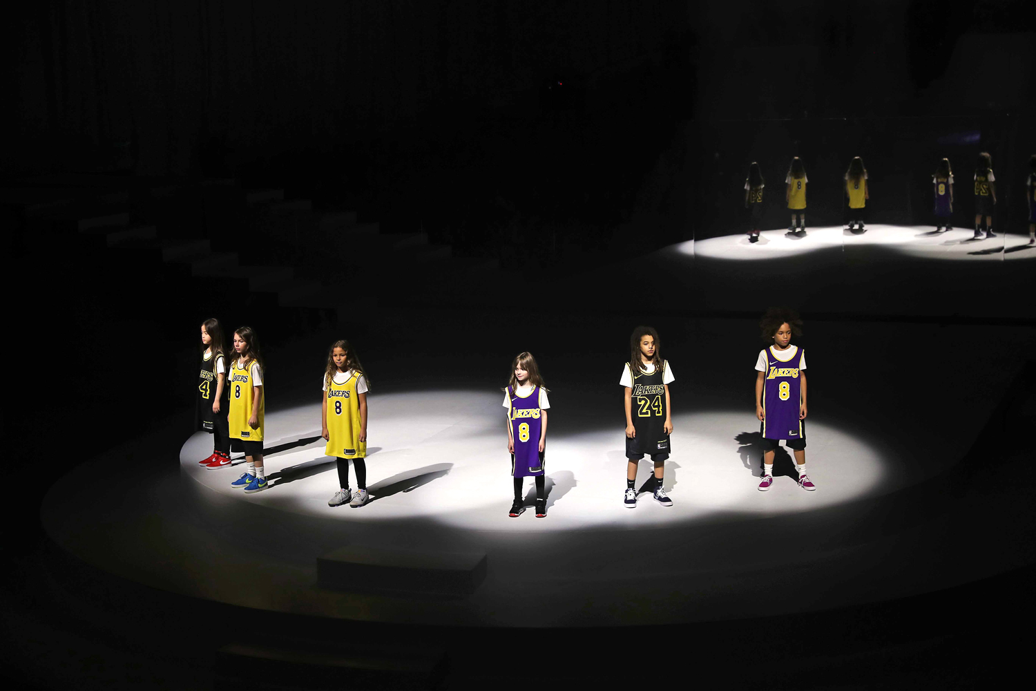 Models are seen honoring Kobe Bryant during the 2020 Tokyo Olympic collection fashion show