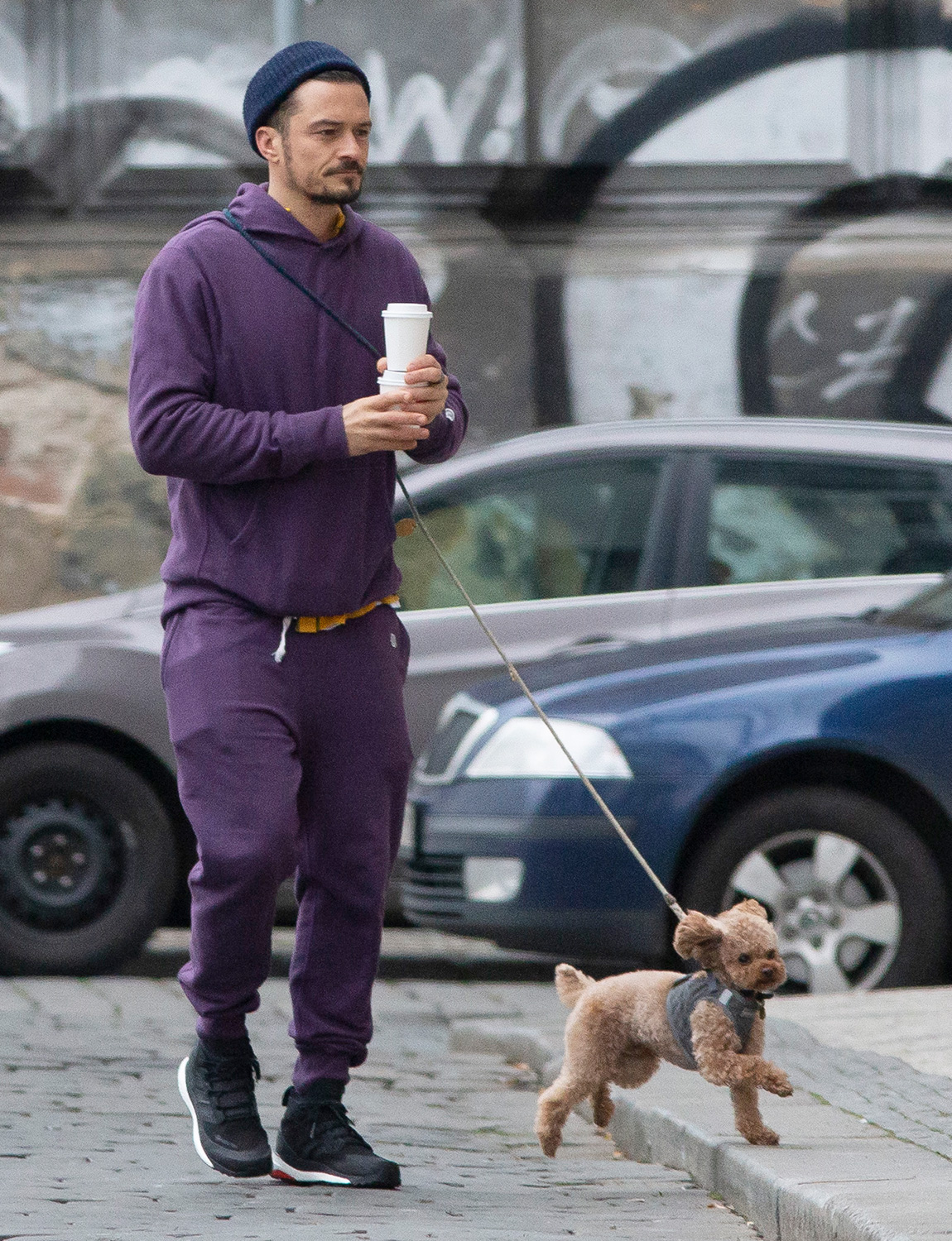 Orlando Bloom takes his dog Mighty out for a walk in Prague, Czech Republic