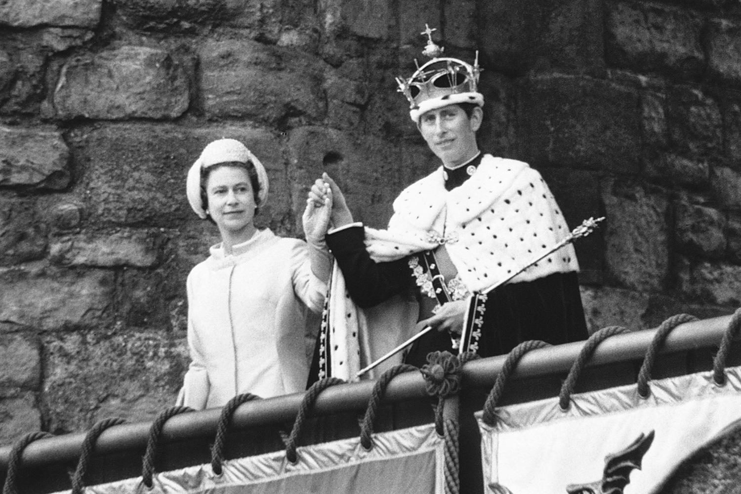 The Queen presents Prince Charles to the people at Caenarvan Castle after his investiture as Prince of Wales. | Location: Caernarvan, Gwynedd, Wales, UK