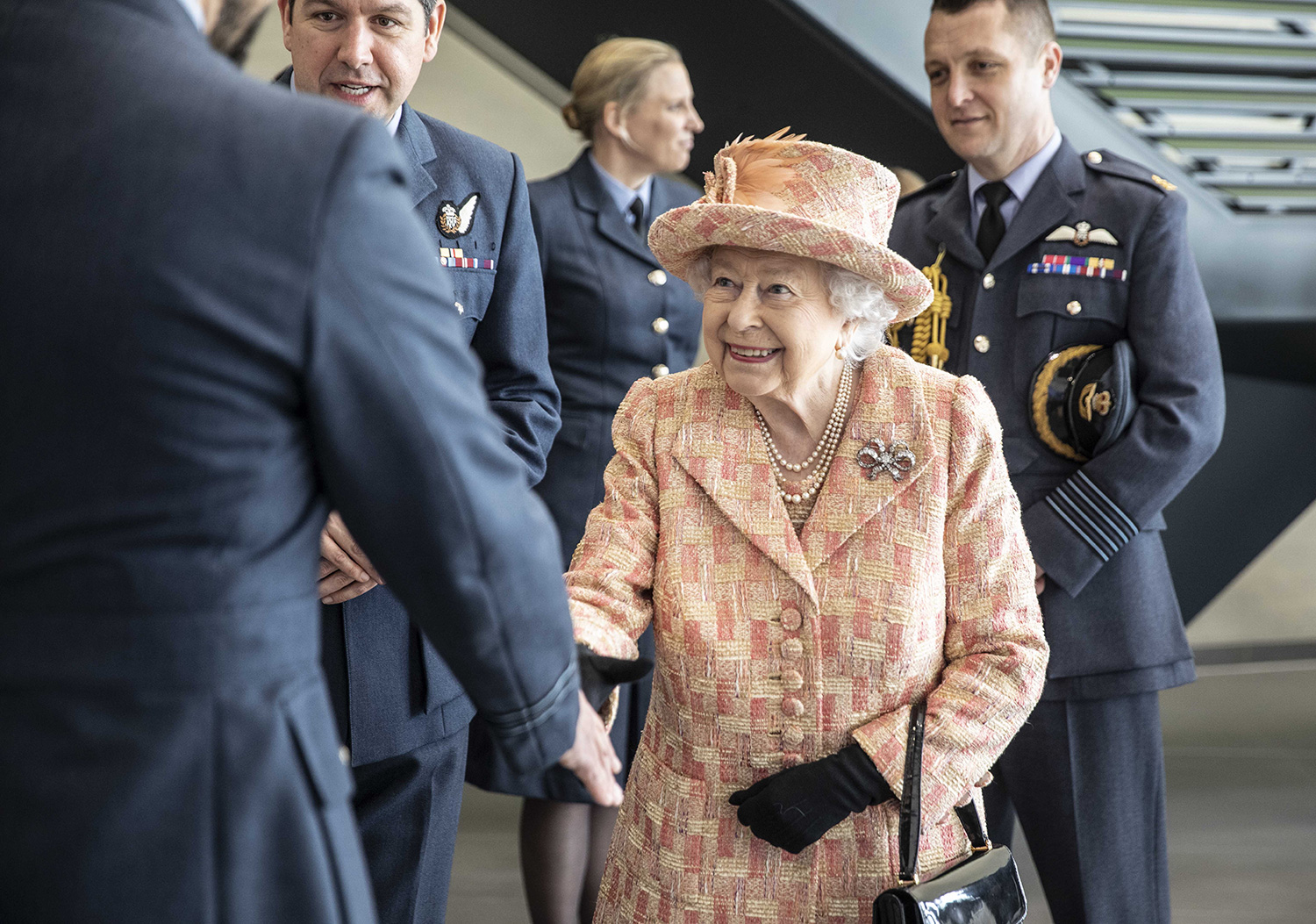 Queen Elizabeth II meets personnel at RAF Marham where she inspected the new integrated training centre that trains personnel on the maintenance of the new RAF F-35B Lightning II strike aircraft at Royal Air Force Marham on February 3, 2020 in King's Lynn, England