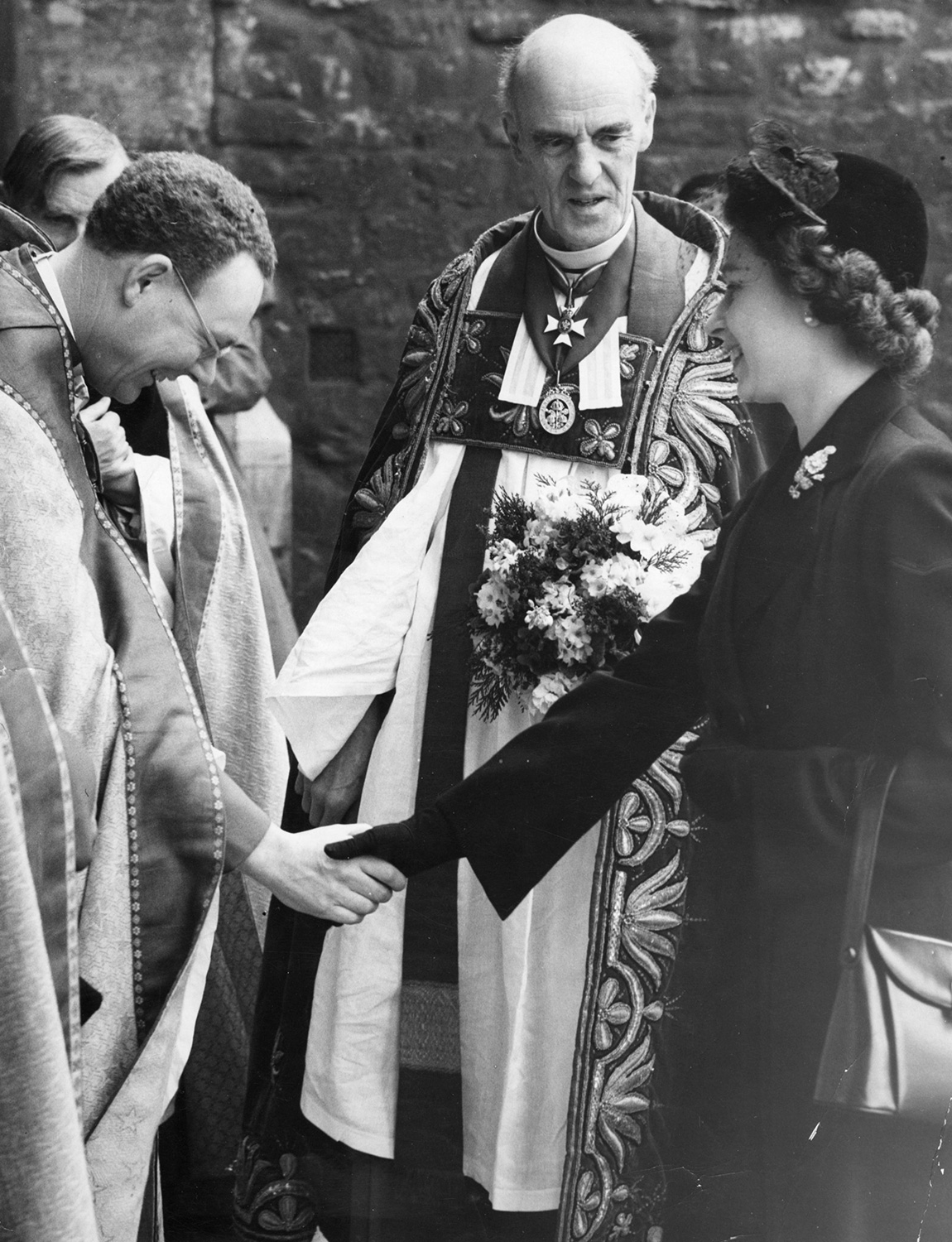 Queen Elizabeth II is greeted by members of the Clergy on her arrival at Westminster Abbey to take part in the traditional Maundy Thursday ceremony, her first public engagement since the beginning of her reign. Centre is Dr. Alan Don, Dean of Westminster