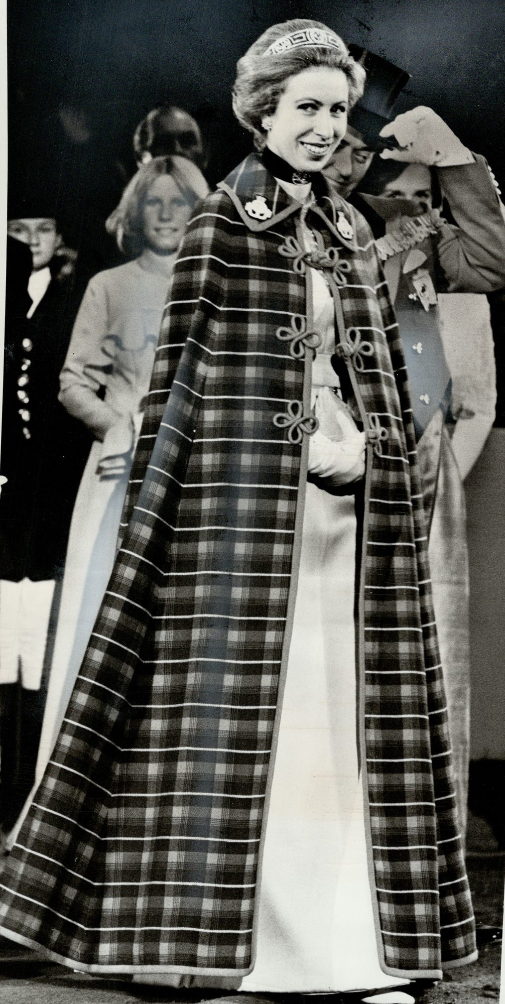 Princess Anne went to the fair in a full-length cloak; It's a cape in regimental colors of the 8th Canadian Hussars