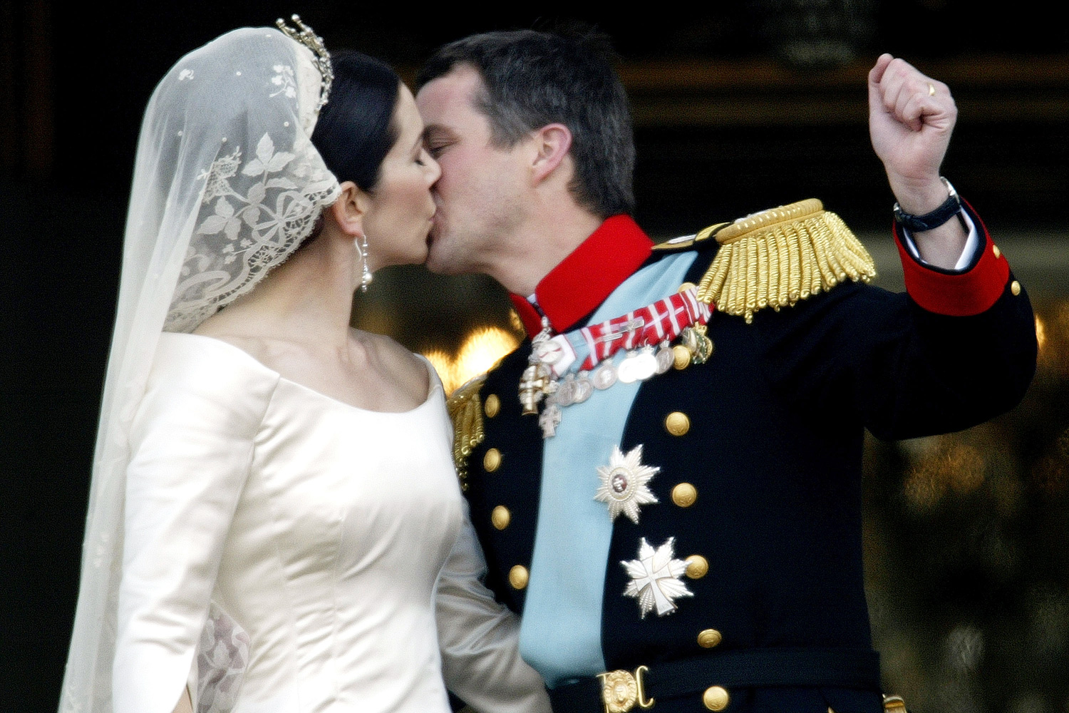 Danish Crown Prince Frederik and his bride Princess Mary kiss as the Royal couple appear on the balcony of Christian VII's Palace after their wedding on May 14, 2004 in Copenhagen, Denmark