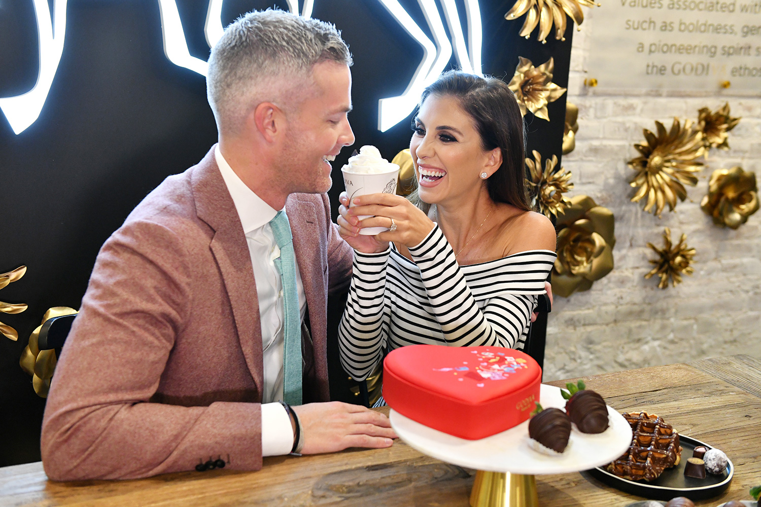 Million Dollar Listing New York stars, Ryan Serhant and Emilia Bechrakis Serhant, shop for Valentines Day gifts at the GODIVA café located in NYCs Flatiron district on February 10, 2020 in New York City