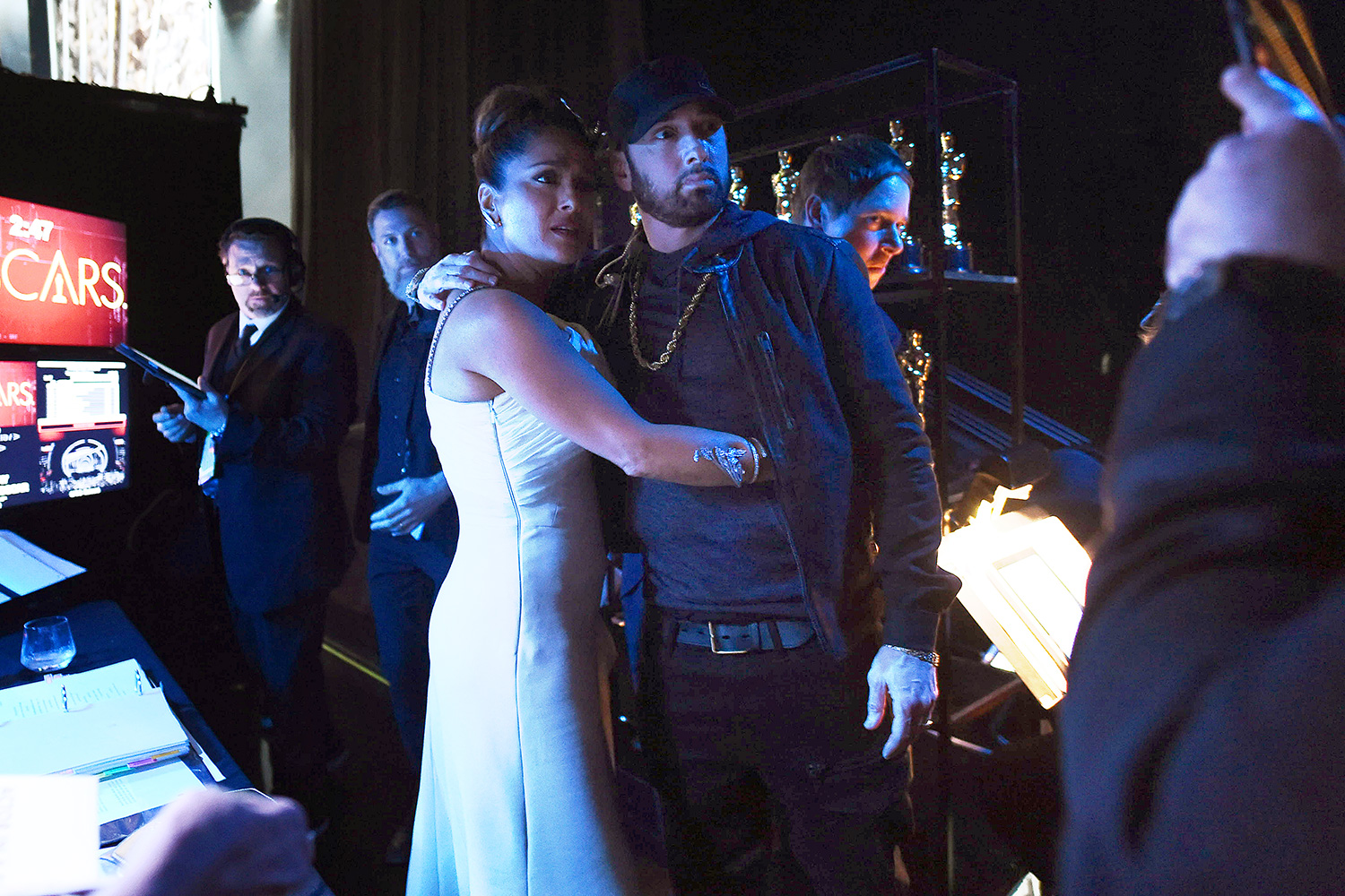 Salma Hayek Pinault and Eminem pose backstage during the 92nd Annual Academy Awards at the Dolby Theatre on February 09, 2020 in Hollywood, California