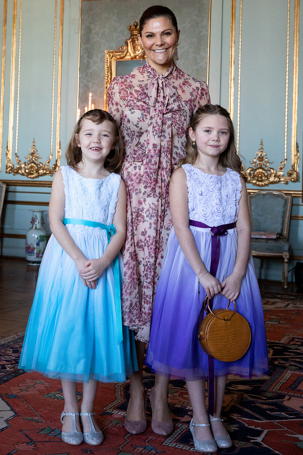 Crown Princess Victoria welcomes Emilia to the Royal Palace