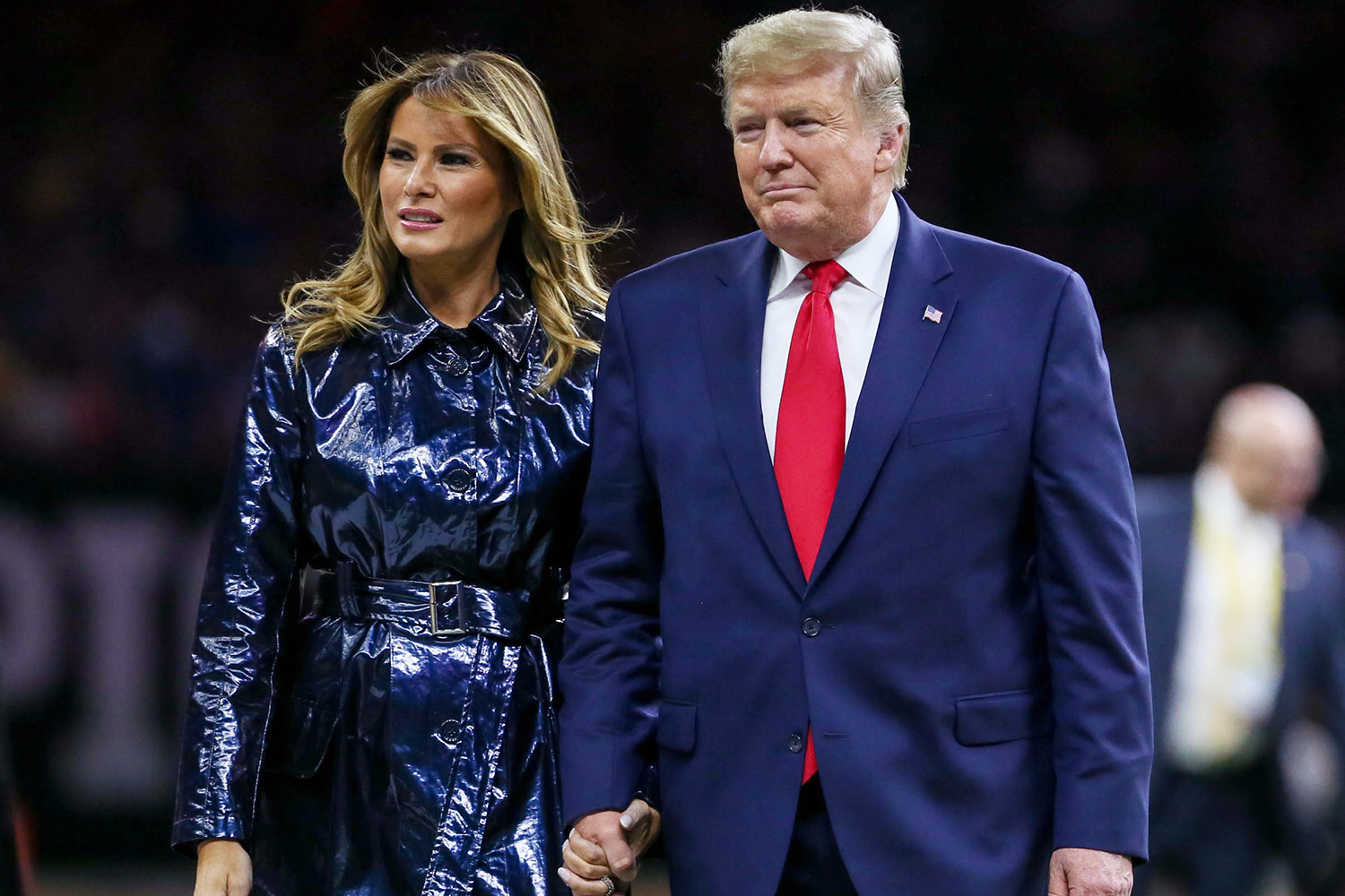President Donald Trump and his wife Melania Trump take the field before the College Football National Championship between the Clemson Tigers and the LSU Tigers at the Mercedes Benz Superdome in New Orleans, LA NCAA Football CFP National Championship Clemson vs LSU, New Orleans, USA - 13 Jan 2020