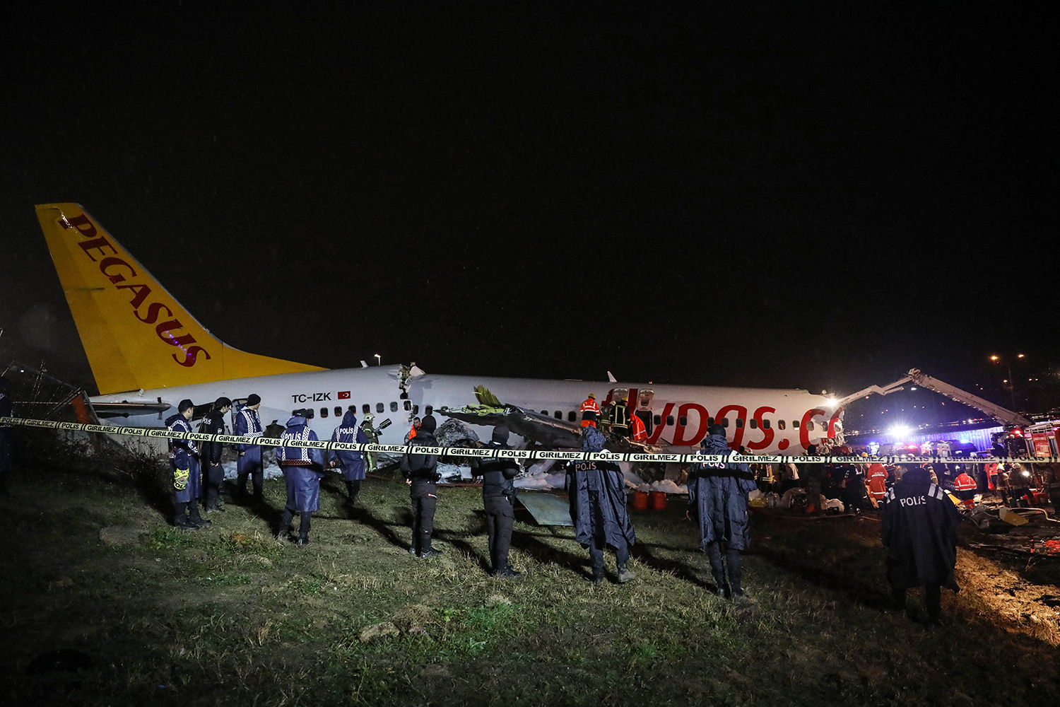 Security personnel cordon off the crash site of a Pegasus Airlines Boeing 737 airplane, after it skidded off the runway upon landing at Sabiha Gokcen airport in Istanbul on February 5, 2020.