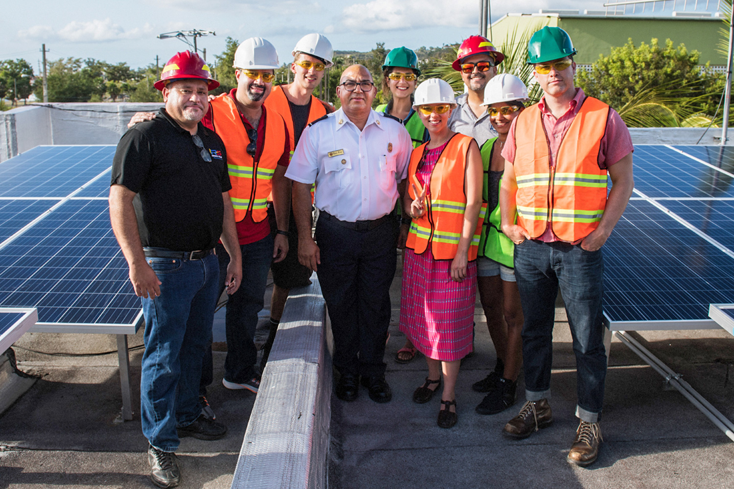 Hunter (behind man in white shirt, Colin Jost to the right) and Scarlett Johansson OMAZE project details:photos are from January 2019 on top of the fire stations in Rincon, Puerto Rico. The solar and battery storage installation will power the critical needs of firefighters that serve the municipality of Rincon, PR. The other people pictured are part of the local solar installation team - the company is called AZ Engineering.
