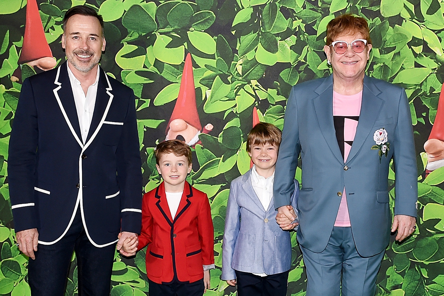 David Furnish (L) and Elton John with sons Elijah and Zachary