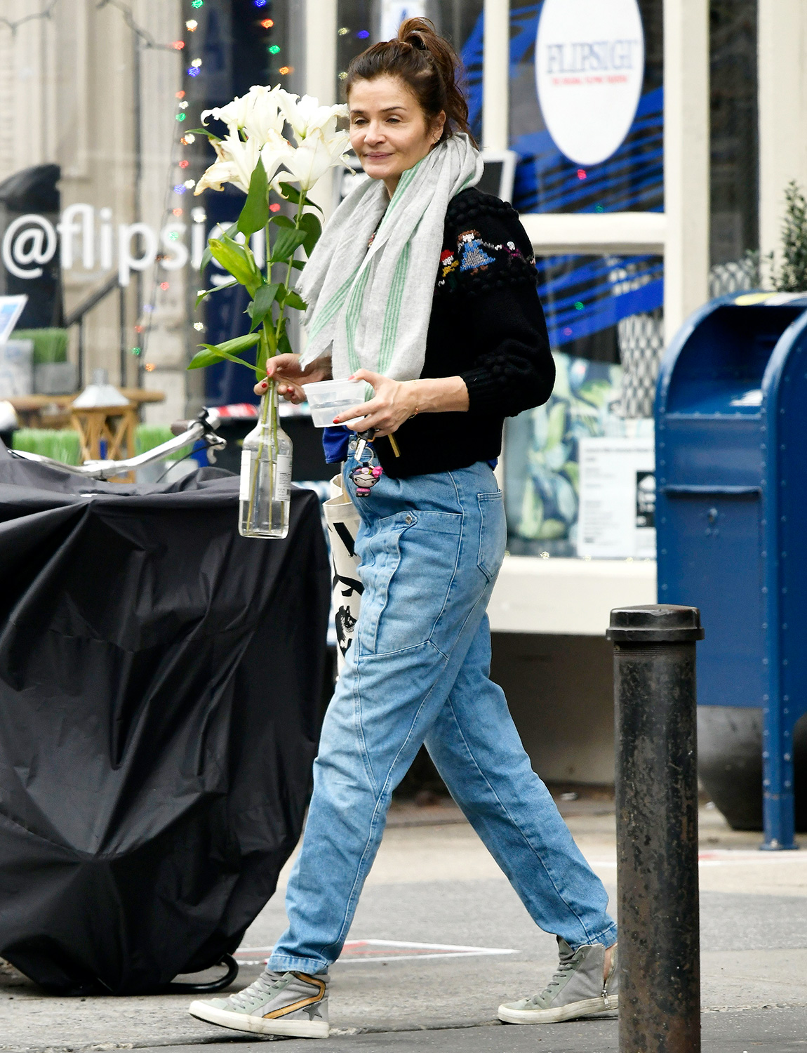 Helena Christensen Carries Fresh Cut Flowers While Out in New York City.