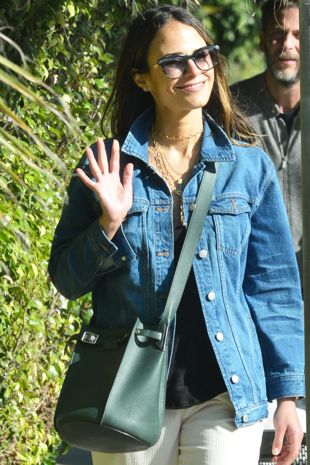 Jordana Brewster Keeps A Sunny Outlook With A Wave Hello And Wearing A Jacket That Says Have A Nice Day As She And Her Family Are Spotted Out For A Walk During The Coronavirus Lockdown In Brentwood, Ca
