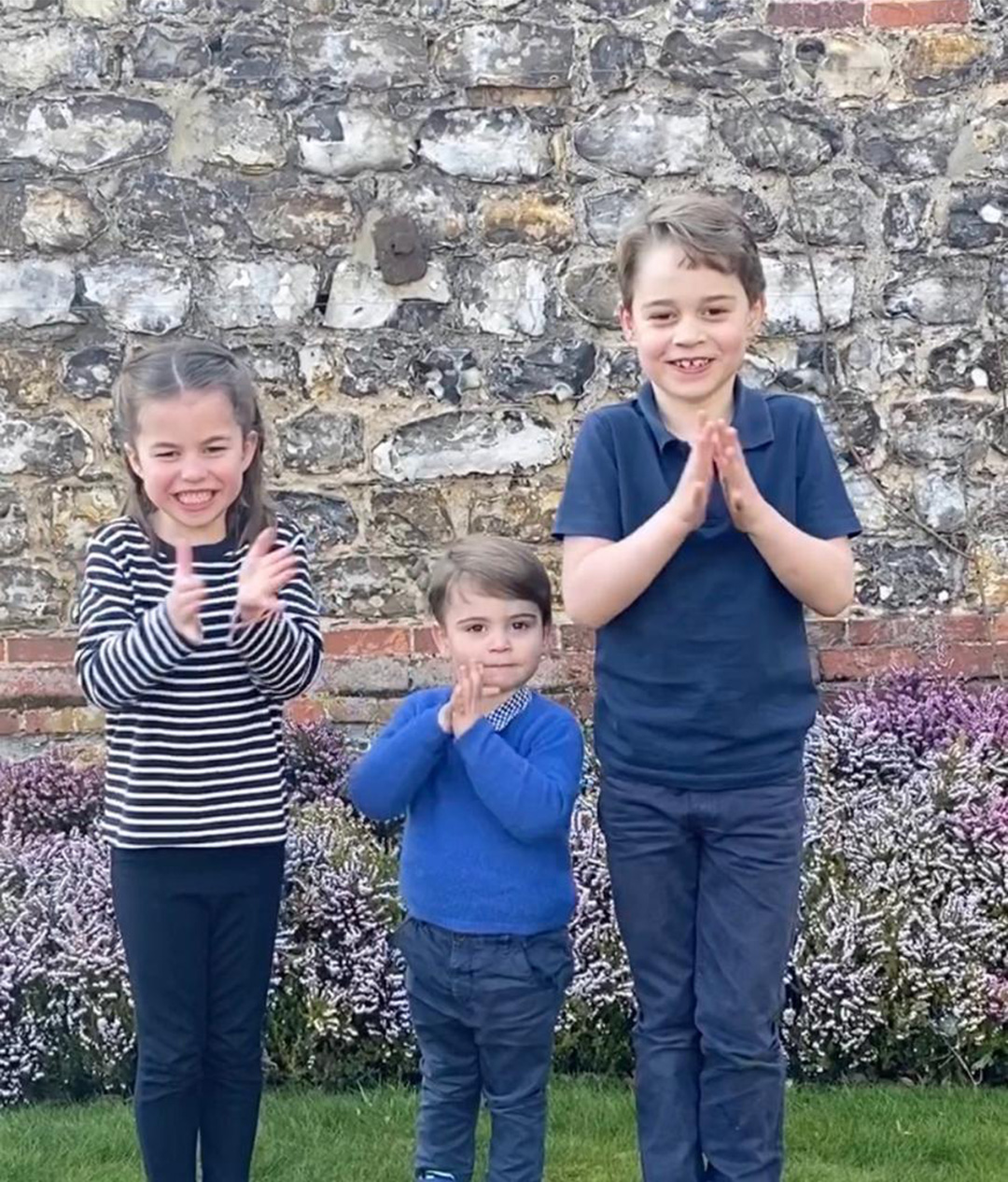Charlotte, Louis, and George applauding the NHS