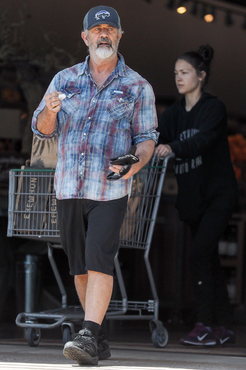 A scruffy Mel Gibson makes a trip to Erehwon Organic this afternoon with girlfriend Rosalind Ross to get some fresh groceries