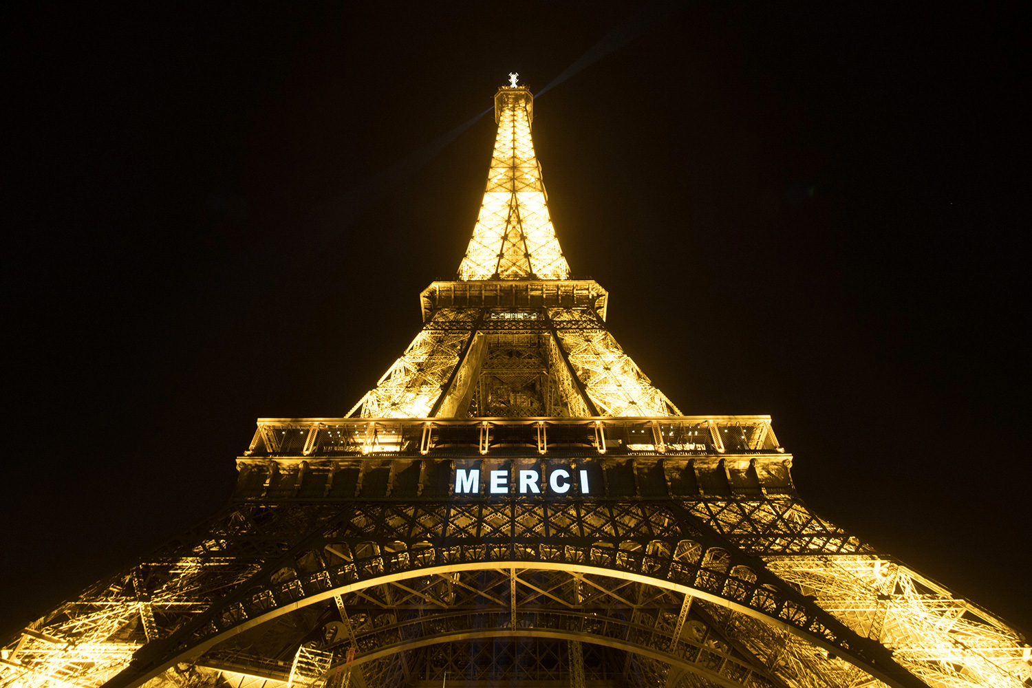 "A general view of the Eiffel Tower with the message ""Merci"" (thank you) to health workers during the coronavirus outbreak on March 28, 2020 in Paris, France"