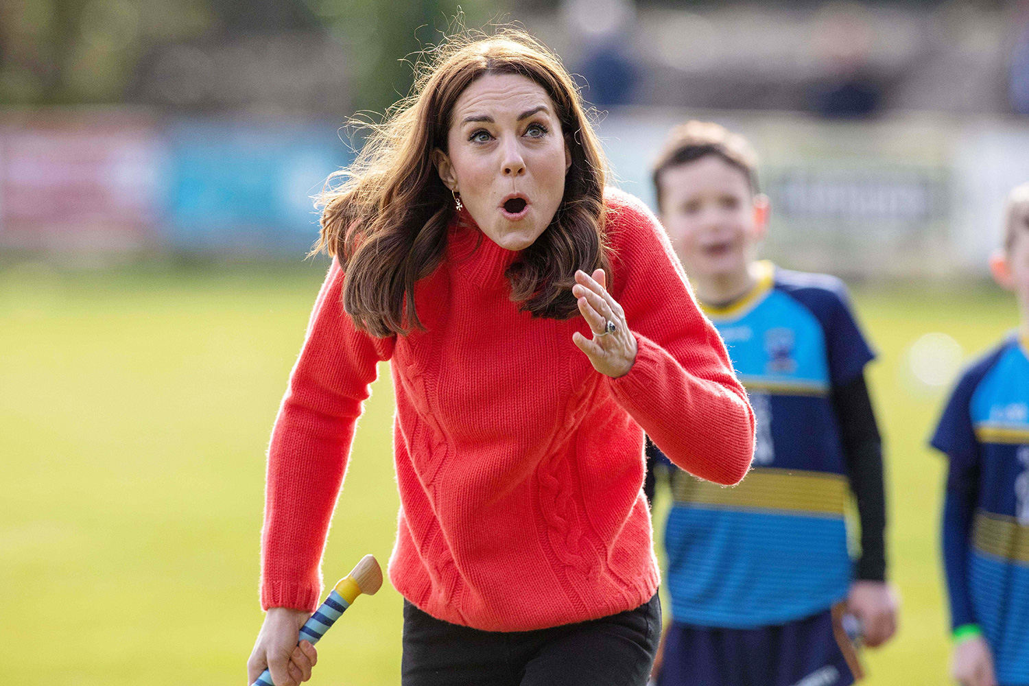 Prince William, Duke of Cambridge (L) reacts as Britain's Catherine, Duchess of Cambridge attempts to play hurling during a visit to Salthill Gaelic Athletic Association (GAA) club in Galway, western Ireland, on March 5, 2020